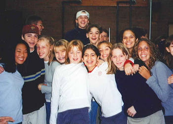 Middle school students in the 1990s smiling for the camera
