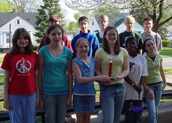 Elementary students holding a trophy in the 2000s